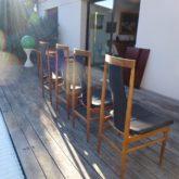 4 chaises en palissandre et cuir